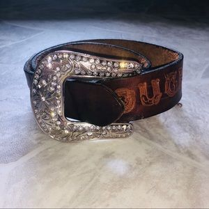 Brown tooled leather built tough western belt